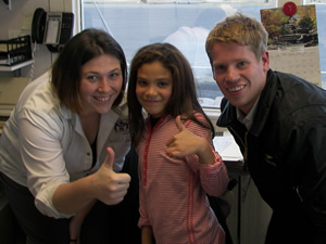 Little Girl with Dispatcher and Flight Instructor after First Flying Lesson