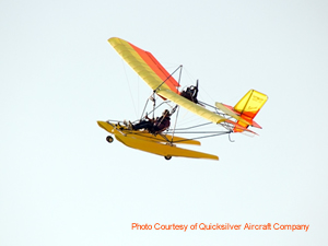 Yellow and Orange Quicksilver MX-II Sprint Light Sport Airplane in Flight