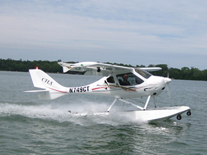 FlightDesign CTLS on floats taking off from the water