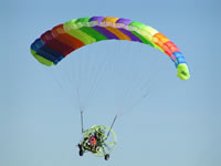 Buckeye Dragonfly Powered Parachute in Flight with two people on board